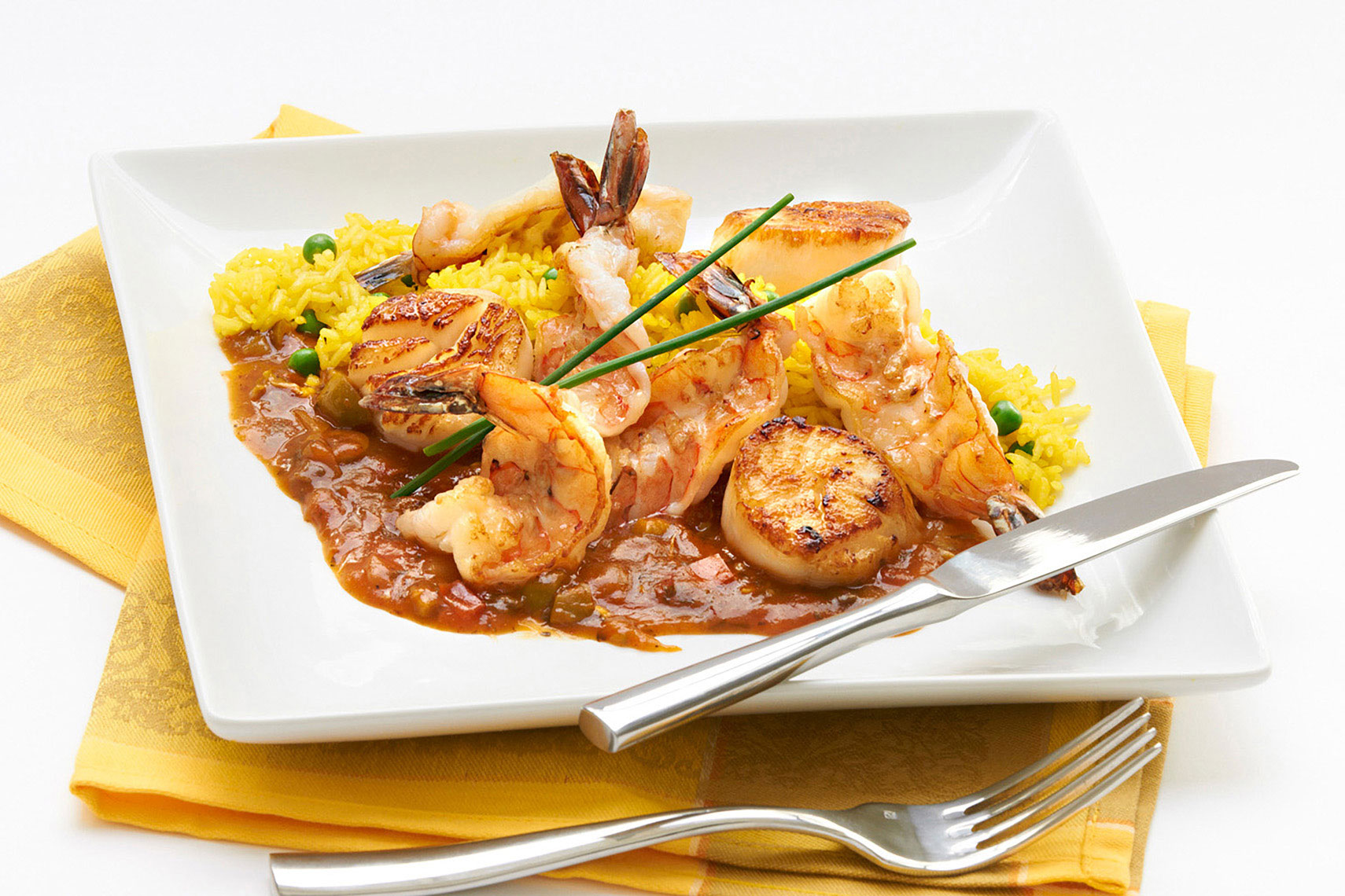 Assian-shrimp-and-scallop-in-red-pepper-sauce-with-safron-rice-by-top-Los-Angeles-food-photographer Joe Atlas.