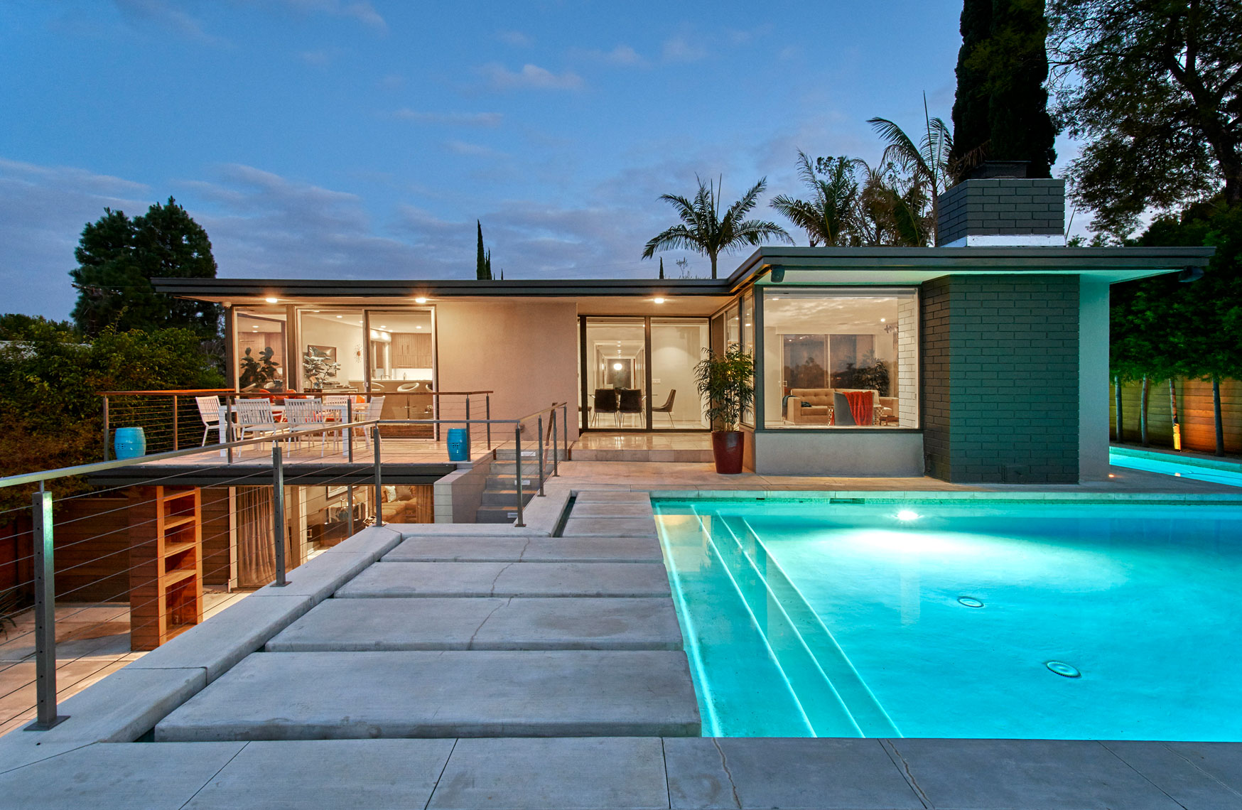 Architectural-photography-of-Mid-century-modern-glass house with pool-at-dusk-Joe-Atlas-architectural-photographer-Los-Angeles.