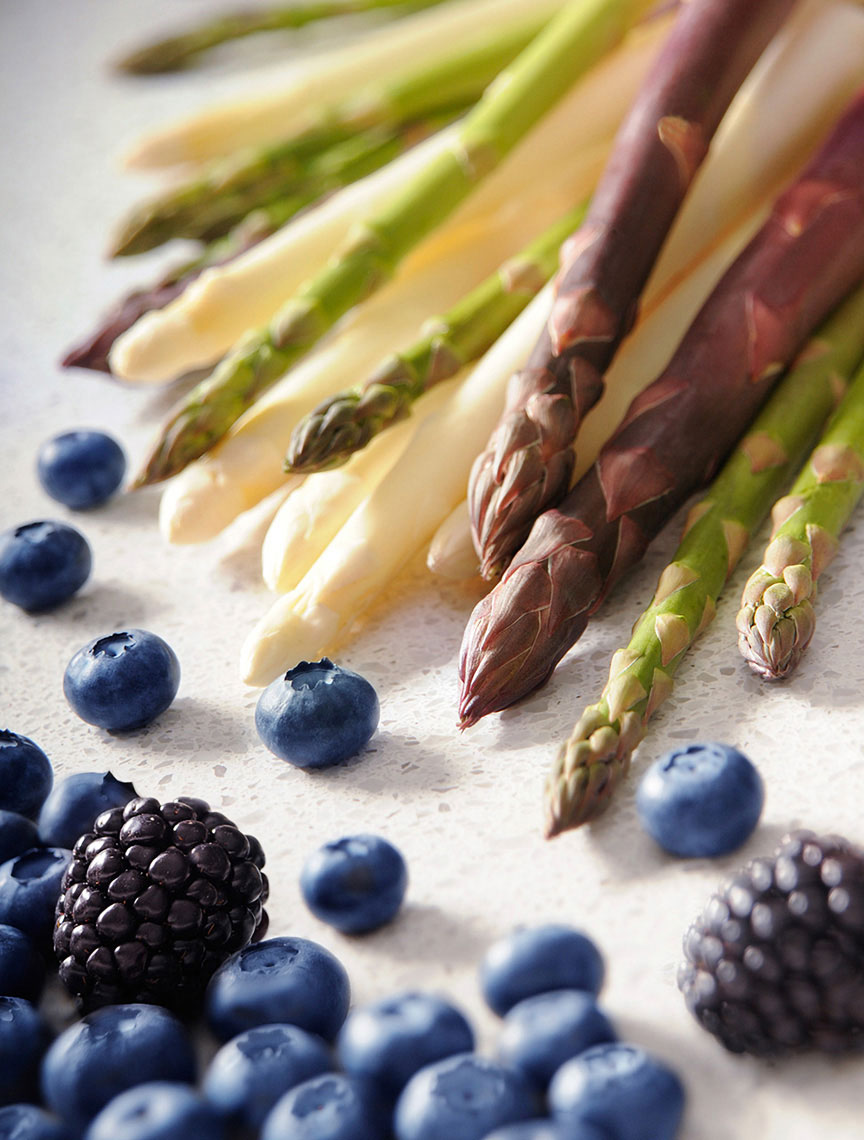 Beautiful-produce-photography-of-blueberries-and-blaclberries-with-green-white-and-purple-asparagus-by-Joe-Atlas-food-photography.