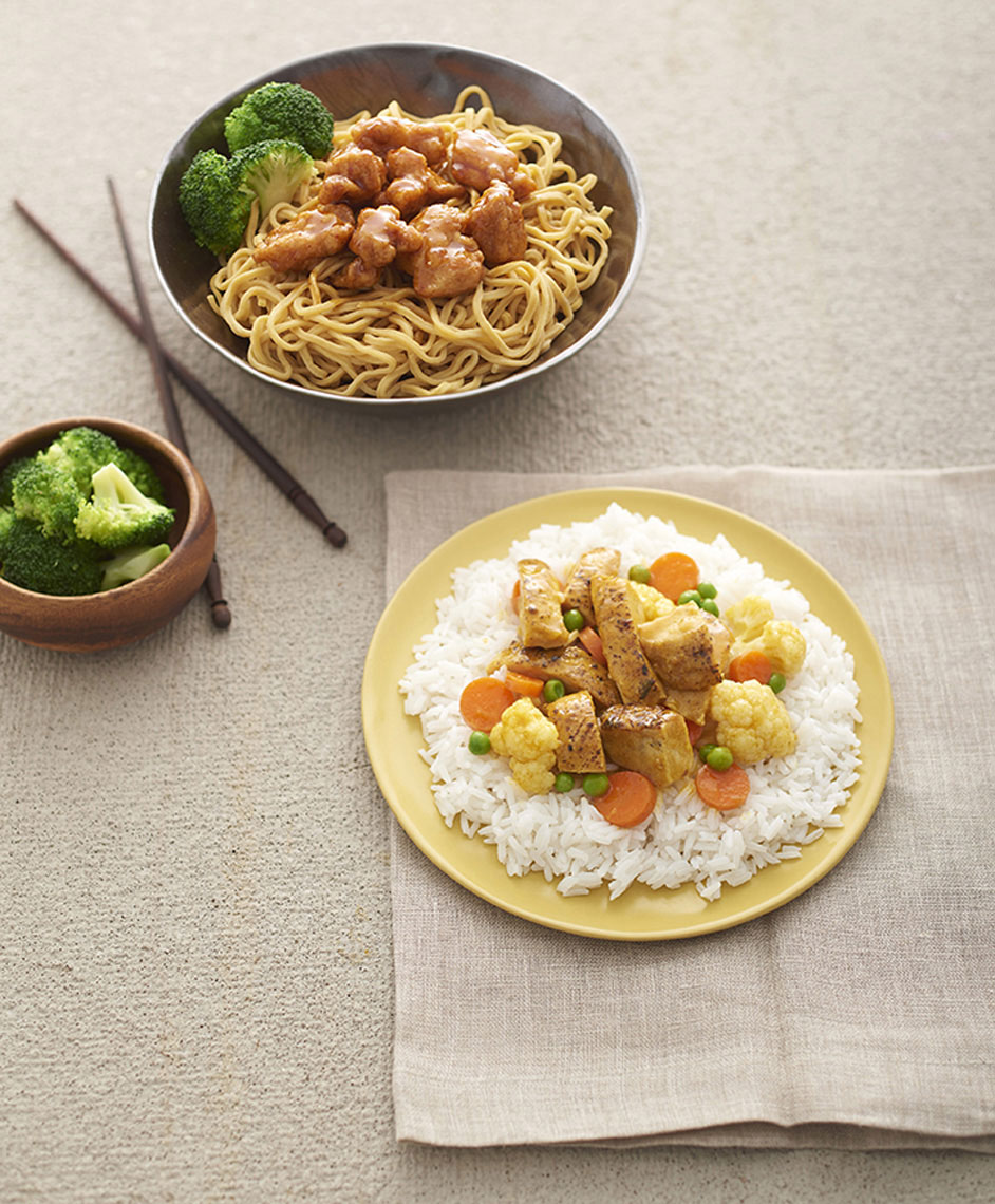 Beautiful-food-photography-of-Curry-Chicken-on-white-rice-and-orange-chicken-on-chow-mein-with-broccoli-by-Joe-Atlas-food-photography.