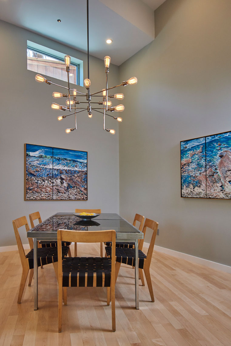 Dining-room-in-contemporary-home-with-pendant-lamp-and-artwork-Joe-Atlas-architectural-photographer-Los-Angeles.