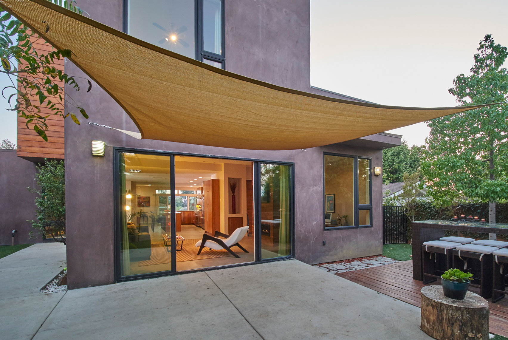 Exterior-rear-twilight-view-through-open-sliding-glass-doors-of-Cypress-park-los-angeles-contemporary-hillside-home