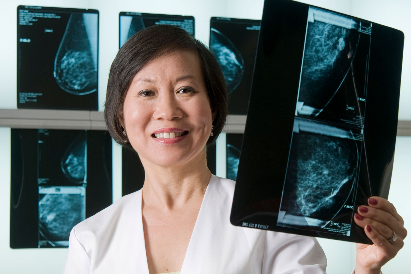 Female-doctor-of-oncology-examines-mammogram-by-environmental-portrait-photographer-Joe-Atlas.