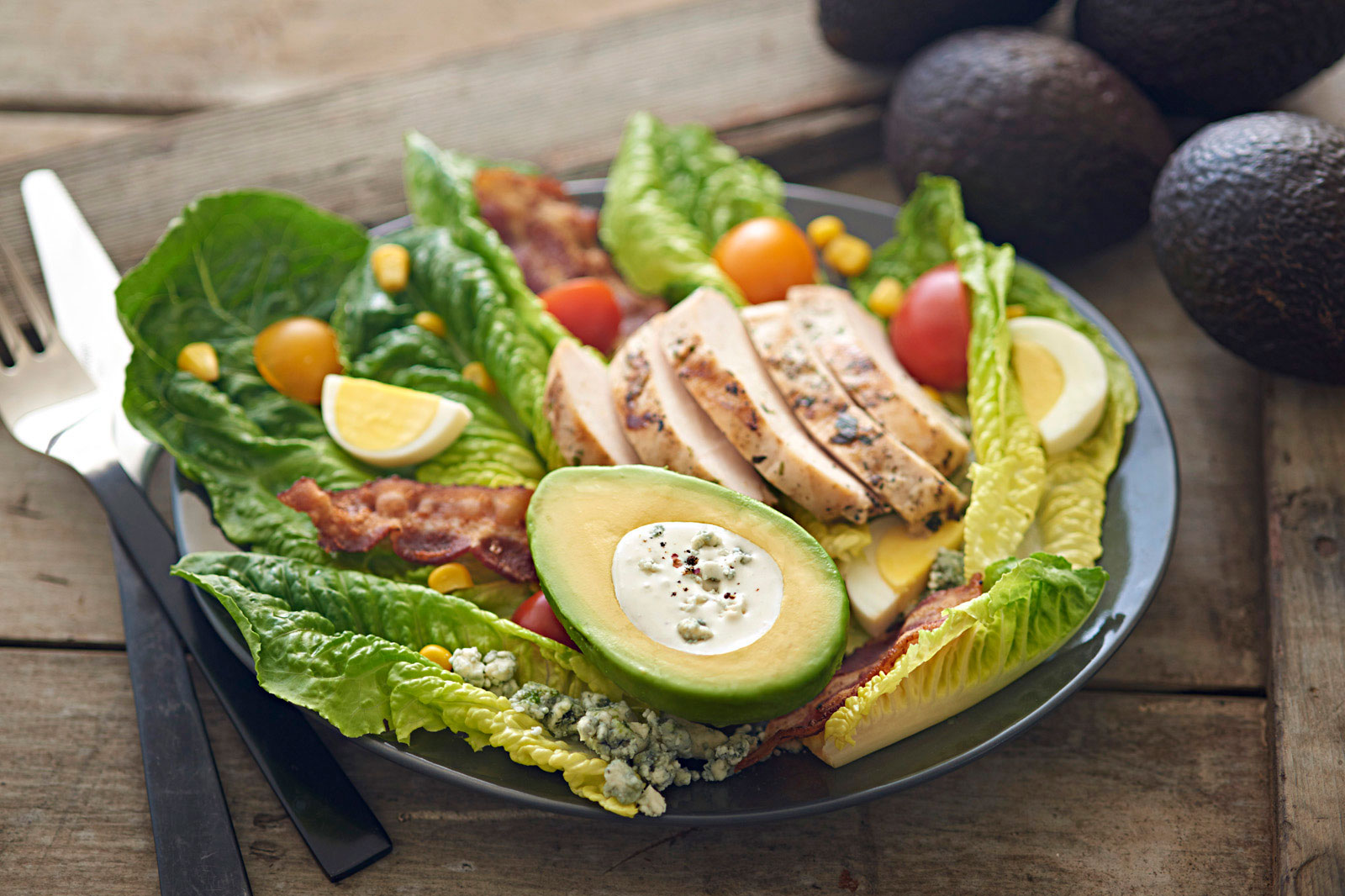 Beautiful-food-photography-of-grilled-chicken-cobb-salad-with-avocado-cup-blue-cheese-dressing