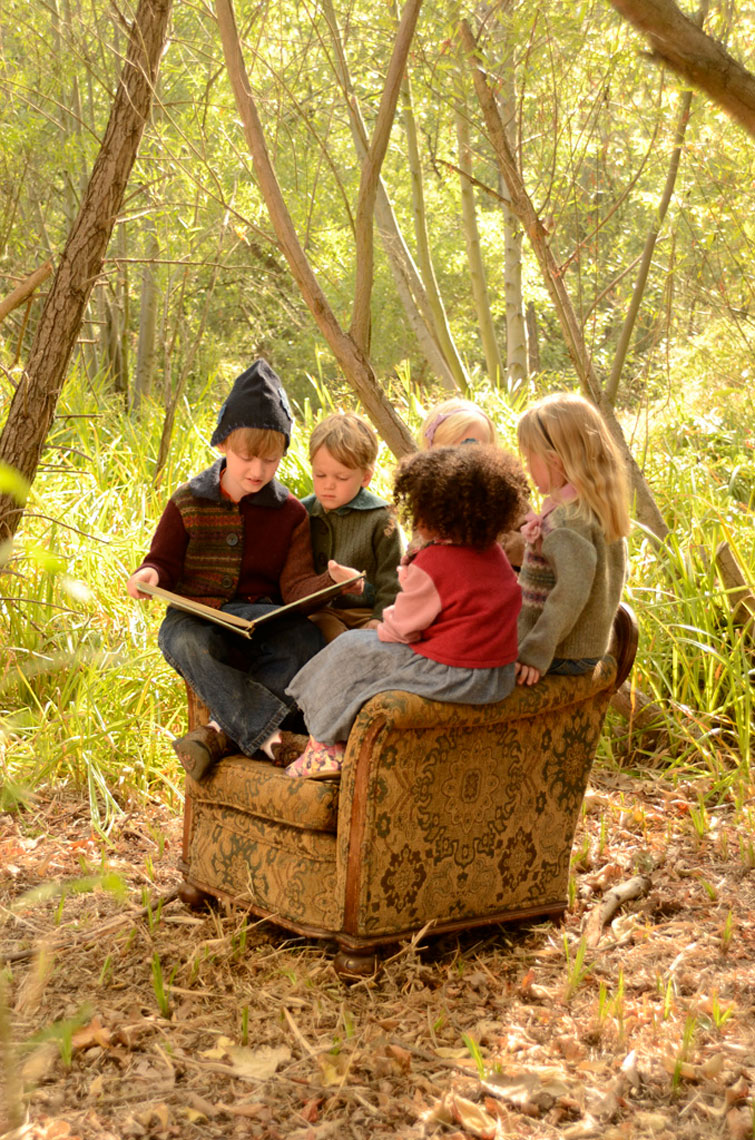 Group-of-children-reading-in-the-woods