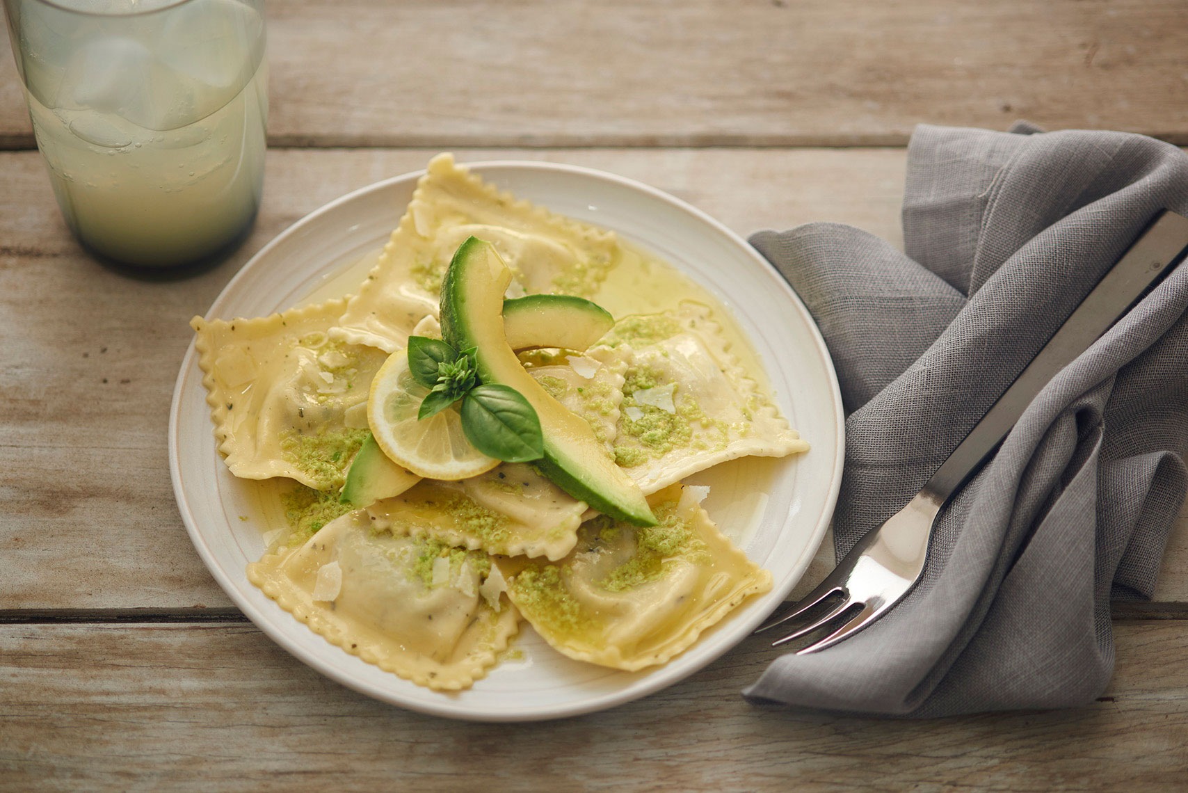 Lemon-ricotta-ravioli-with-avocado-sauce-parmesean-cheese-and-fresh-basil-garnish-by-Los-Angeles-food-photographer