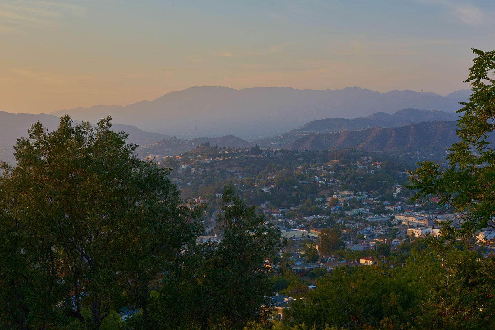 Los-angeles-homes-and-San-Gagrial-mountains-at-dusk-from-roof-top-deck-of--contemporary-home
