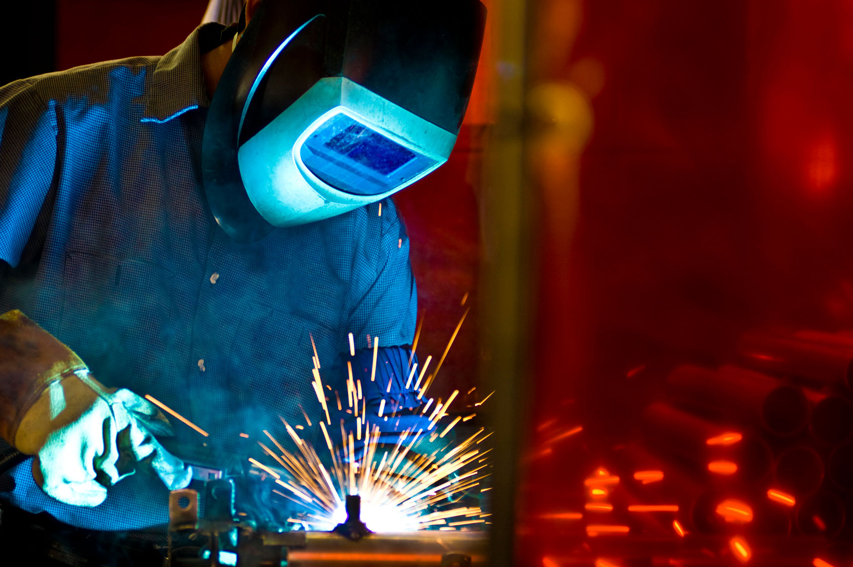 Metal-Welder-by-annual-report-photographer-Joe-Atlas.