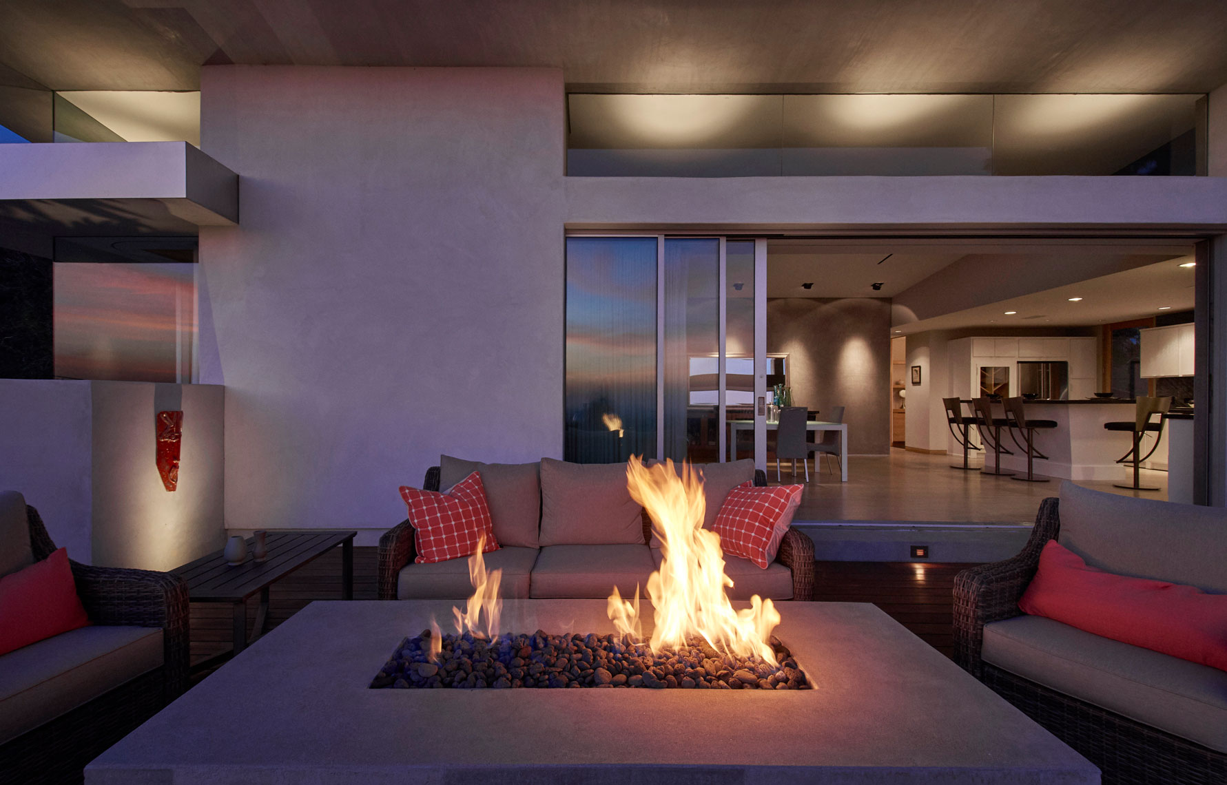 Outdoor-fireplace-with-view-of-contemporary-home-interior-in-background-by-top-Los-Angeles-architecture photographer