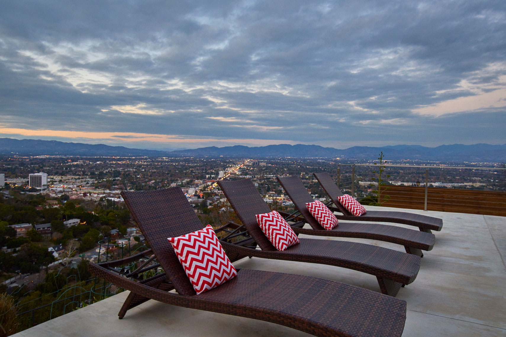 Twilight-view-of-San-Fernando-valley-from-poolside-lounge-chairs