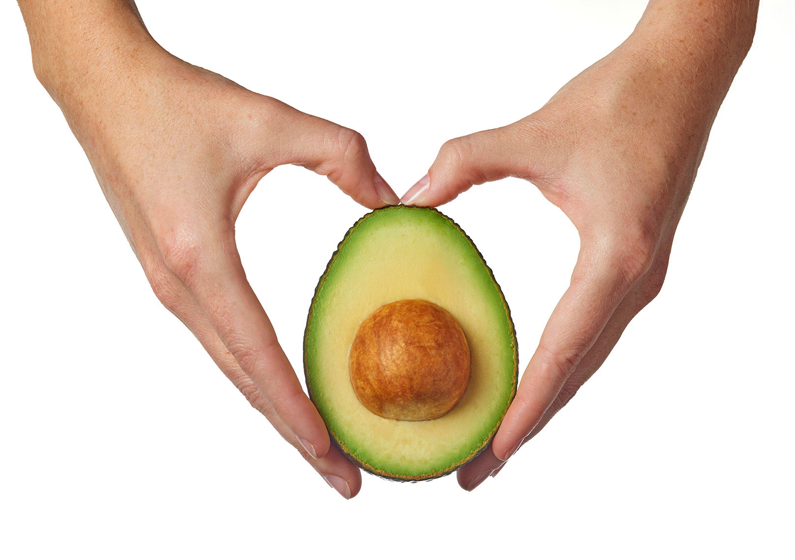 Two-hands-in-the-shape-of-a-heart_holding-half-of-a-cut-avocado-by-Joe-Atlas-food-photography.