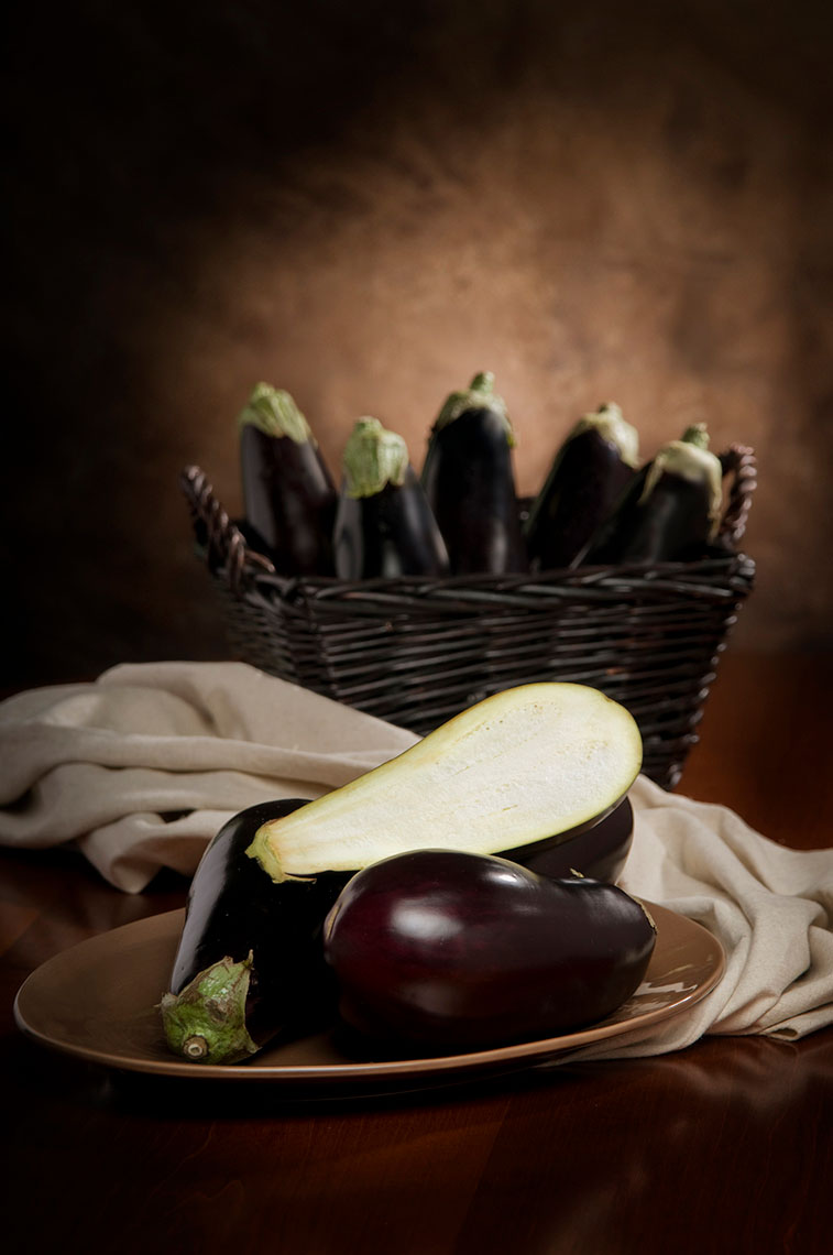 Whole-and-cut-eggplants-on-a-plate-and-in-a-basket-by-Joe-Atlas-food-photography.