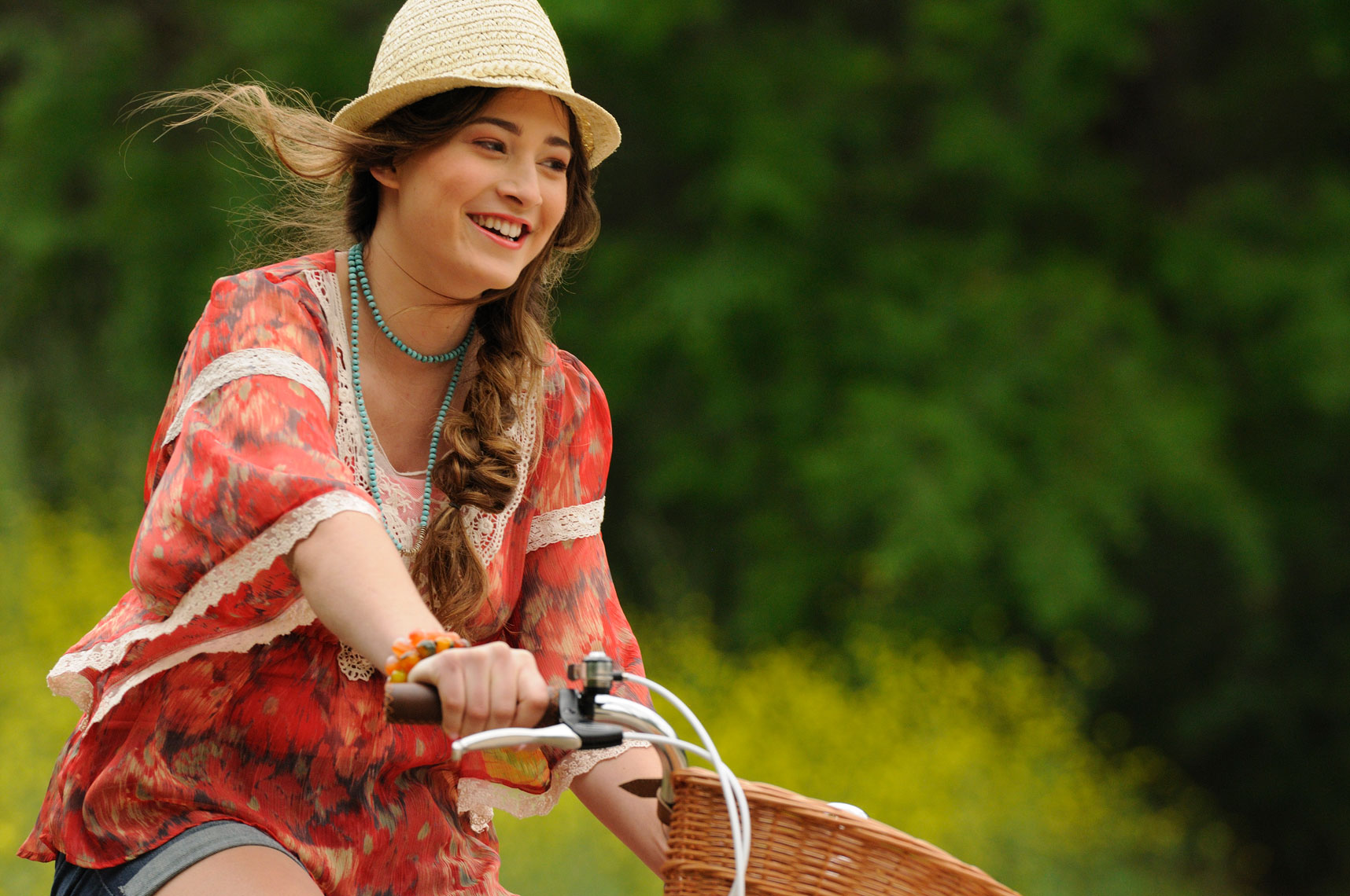 Young-woman-riding-a-bike-and-smiling